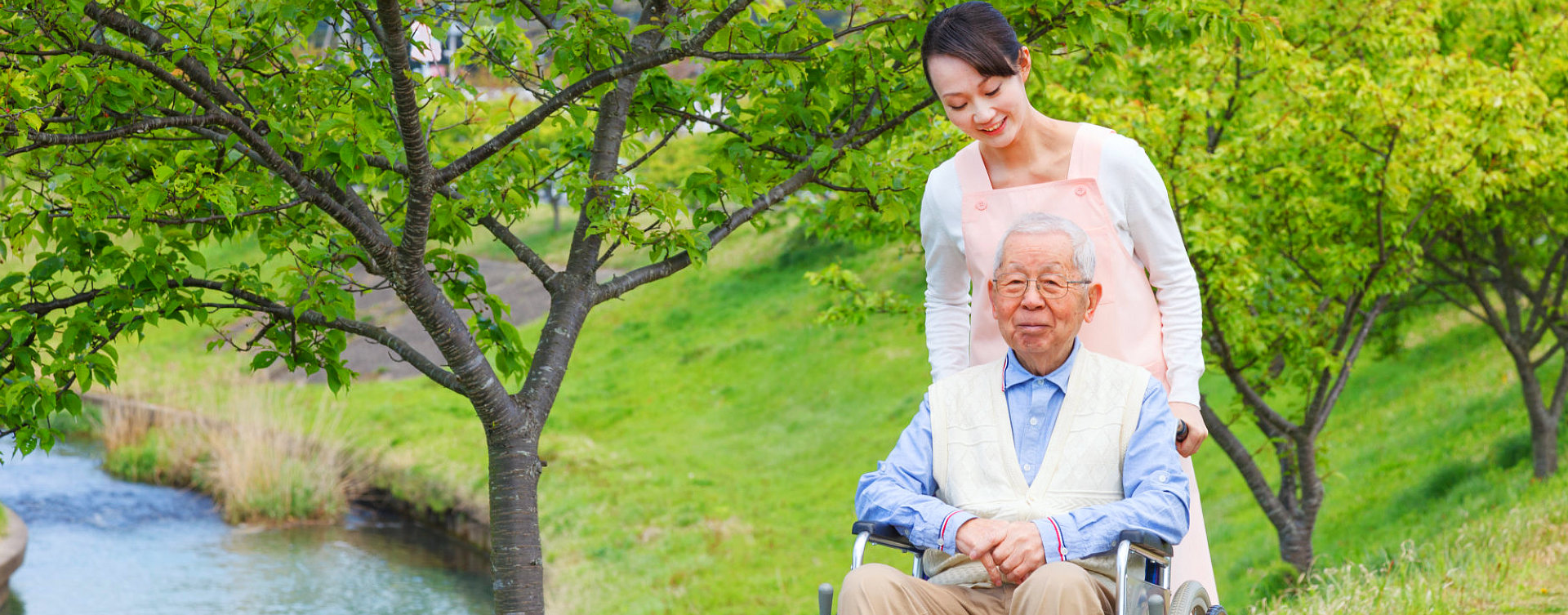 caregiver assisting elder man outdoor