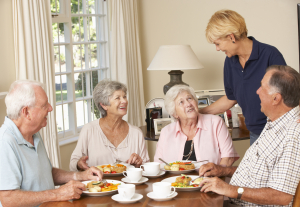 elderly women dining with her friends in the large dining area